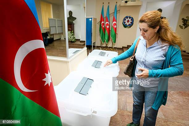 An Azeri woman casts her ballot paper during the voting at a polling station in Baku Azerbaijan Azerbaijan Holds Constitutional Referendum today