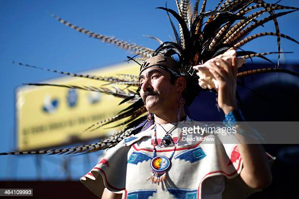 An Aztec dancer marches in the 29th annual Kingdom Day Parade on January 20 2014 in Los Angeles California The Kingdom Day Parade honors the memory...
