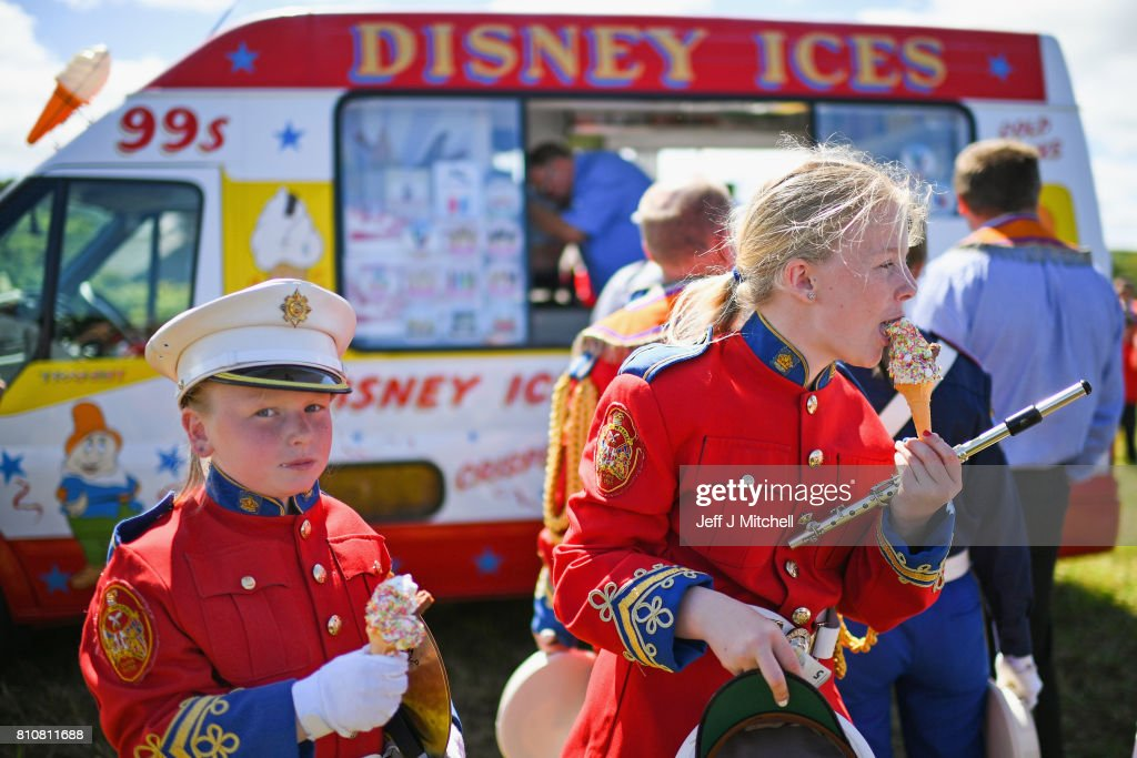 An Band girls eat ice cream following taking part in the annual pre Twelfth of July Orange parade held in Rossnowlagh on July 8, 2017 in Donegal, Ireland. The demonstration in Rossnowlagh is traditionally held the Saturday before the Twelfth of July parades across the border in the north of Ireland. The annual Orange marches and demonstrations celebrate the Battle of the Boyne in 1690 when the Protestant King William of Orange defeated the Catholic King James II on the banks of the river Boyne.