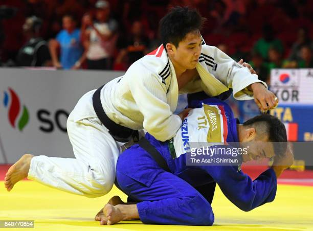An Baul of South Korea and Fabio Basile of Italy compete in the Men's 66kg third round during day two of the World Judo Championships at the Laszlo...