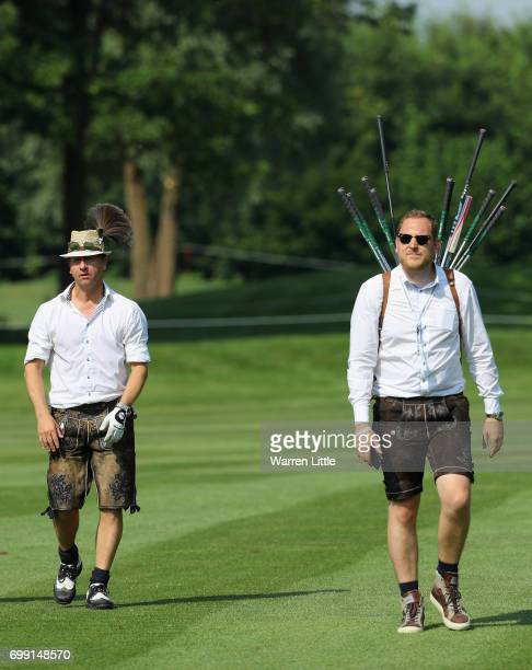 An Bavarian amateur and his caddie compete during the proam event ahead of the BMW International Open at Golfclub Munchen Eichenried on June 21 2017...