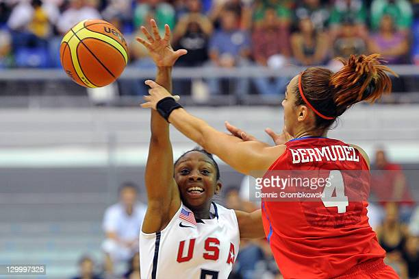 An Bermudez of Puerto Rico is challenged by Valencia Treniece McFarland of the USA battle for the ball during the Women's Basketball Group A...