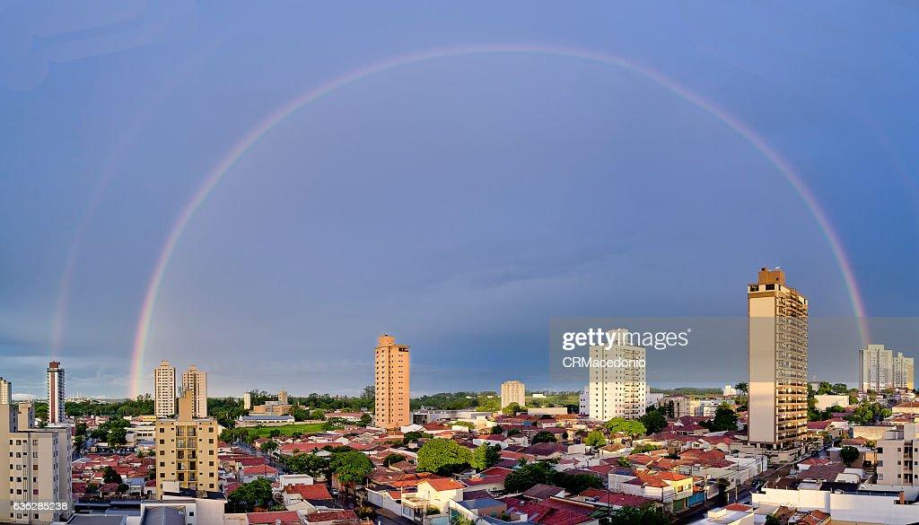 An big rainbow over city. : Stock Photo