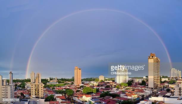 an big rainbow over city. - crmacedonio stockfoto's en -beelden