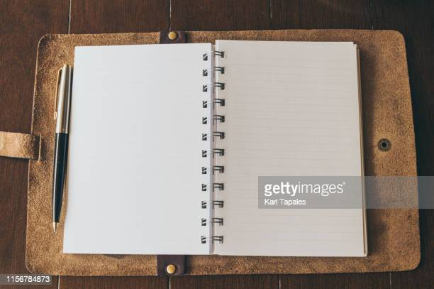 an blank notepad paper on a coffee table - viewpoint stock pictures, royalty-free photos & images