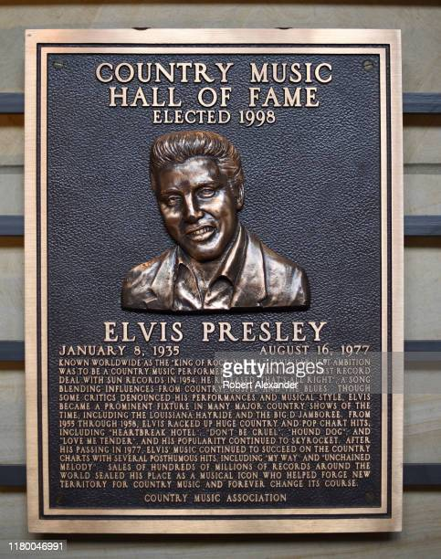 An bronze plaque honoring Elvis Presley as a member of the Country Music Hall of Fame on display at the Country Music Hall of Fame and Museum in...