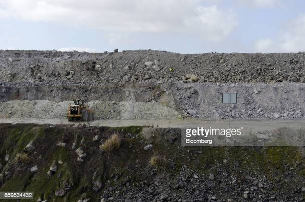 An bulldozer operates in an open pit mine at a Talison Lithium Ltd site a joint venture between Tianqi Lithium Corp and Albemarle Corp in Greenbushes...