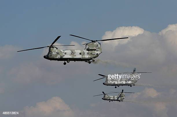 An CH47 Chinook helicopters hover during the South Korea and US joint military exercise at the Seungjin firing drill ground on August 28 2015 in...