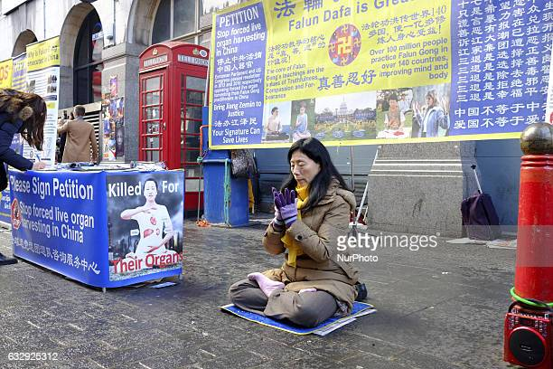 An Chinese devotee offers prayers in London's Chinatown to celebrates New Year in London on January 28 2017 The Lunar New Year marks the start of the...
