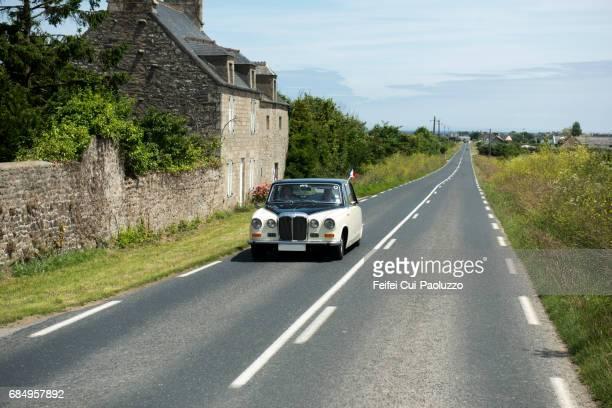 An classic vintage car at road near Barfleur, Normandy Region, France
