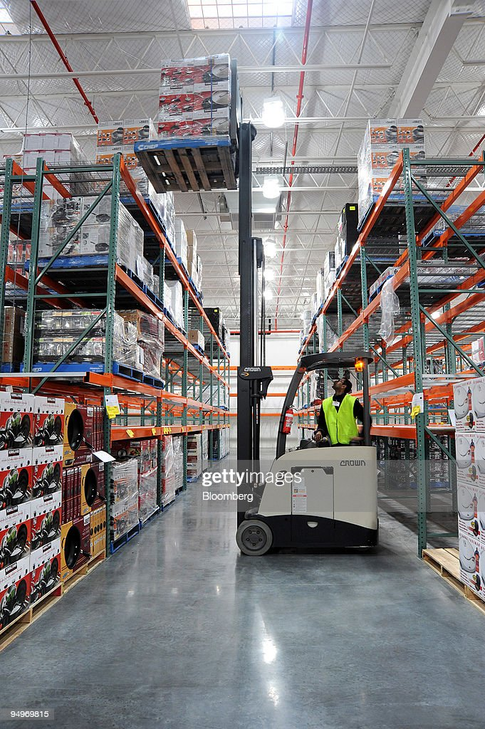 An costco wholesale corp employee uses a forklift truck to pictures an costco wholesale corp employee uses a forklift truck to stack pallets on shelves as thecheapjerseys Images