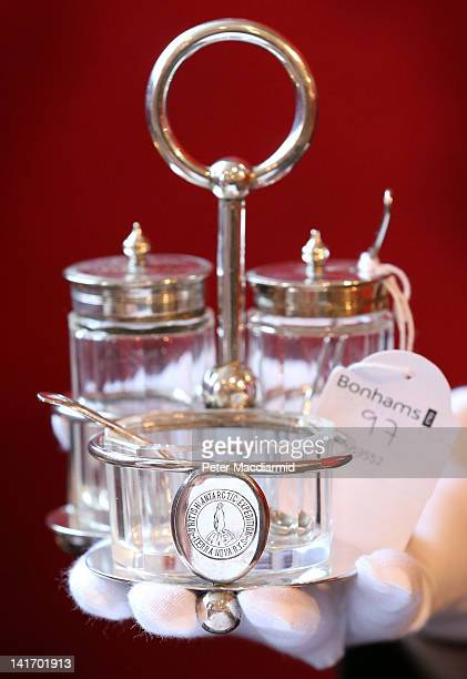 An cruet set from the expedition ship the Terra Nova's wardroom is displayed at Bonhams auctioneers on March 22 2012 in London England The set forms...