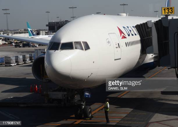 An Delta Airlines plane sits on the tarmac at Los Angeles International Airport in Los Angeles on October 29, 2019.