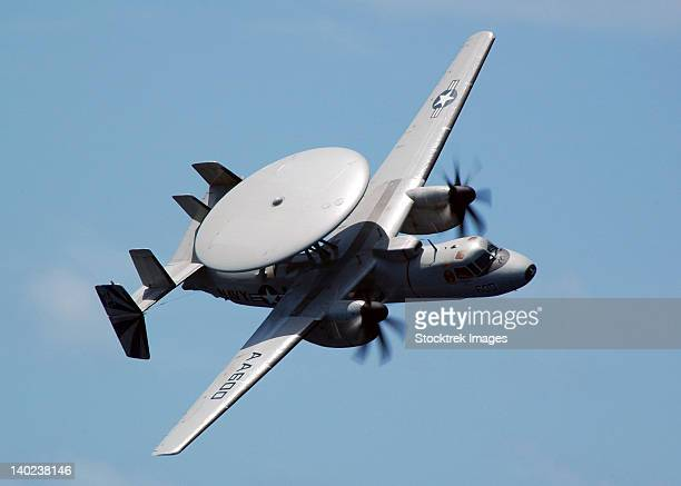 An E-2C Hawkeye executes a high performance fly-by during an Air Power Demonstration.