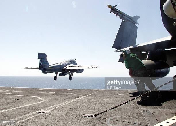 """An EA-6B """"Prowler"""" launches from the flight deck October 23, 2001 of the aircraft carrier USS Carl Vinson. The Carl Vinson is conducting missions in..."""