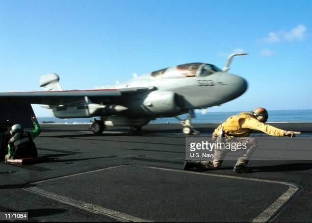 """An EA-6B """"Prowler"""" launches October 20, 2001 from the deck of the aircraft carrier USS Carl Vinson. Aircraft from the Carl Vinson are being used to..."""