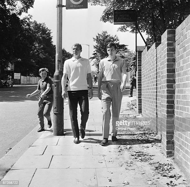 An eager young football fan chases England footballers Bobby Moore and Martin Peters as they stroll near the team's hotel in Hendon London 23rd July...