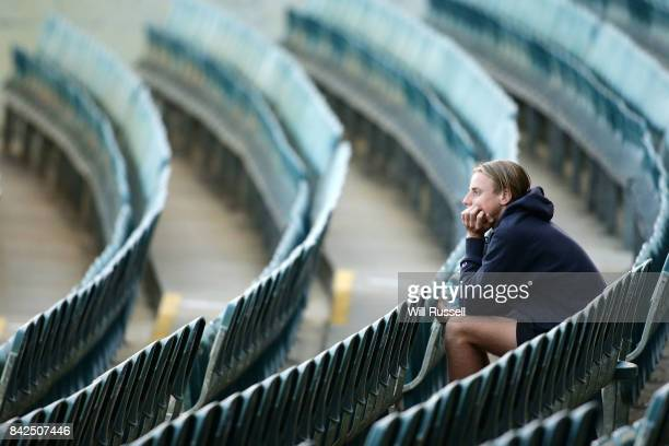 An Eagles fan watches proceedings during a West Coast Eagles AFL training session at Domain Stadium on September 4 2017 in Perth Australia