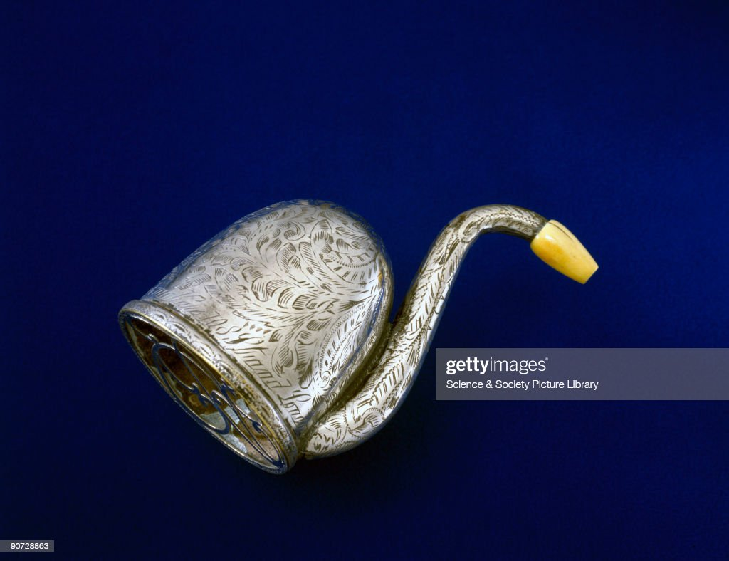 An ear trumpet made of brass, with an ivory earpiece, made