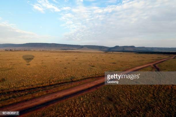 An early morning hot air balloon flight over the African savanna Masai Mara game reserve Kenya