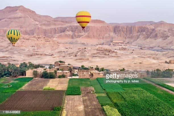 an early morning hot air balloon ride by the valley of the kings - luxor, egypt - egypt stock pictures, royalty-free photos & images
