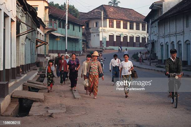 An early morning street scene in Chieng Tung in a small town in Shan State Burma Most of the people are heading to the local market to buy or sell...