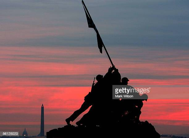 An early morning sun begins to rise over the Iwo Jima Memorial November 9 2005 in Arlington Virginia On November 19 the US Marines will celebrate...
