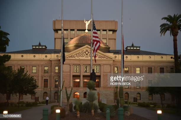 An early morning view before the casket of Senator John McCain is carried by members of the Arizona National Guard to the Arizona State Capitol...