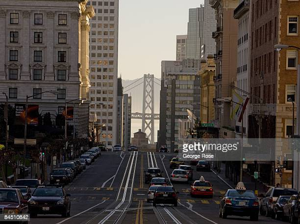 An early morning view of Bay Bridge and down California Street is seen in this 2009 San Francisco California city landscape photo taken from Nob Hill