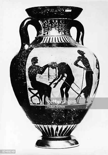 An early Olympiad depicted on an ancient black figure Greek vase circa 450 BC The winner bends to receive an olive crown