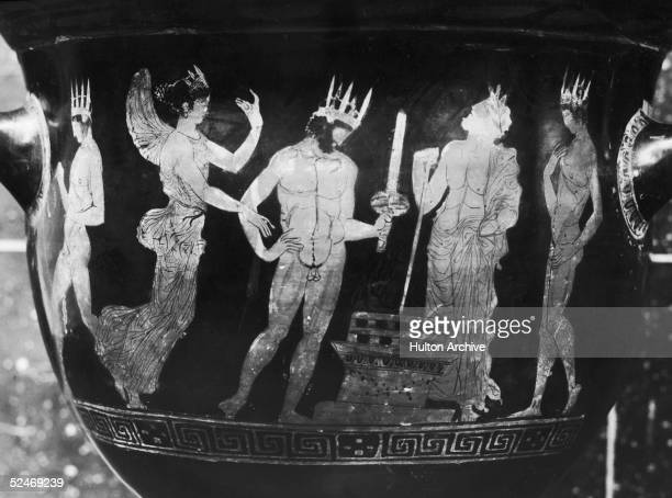 An early Olympiad depicted on an ancient red figure Greek vase or krater circa 450 BC The winner of the Lampadedromia or torch relay lights his torch...