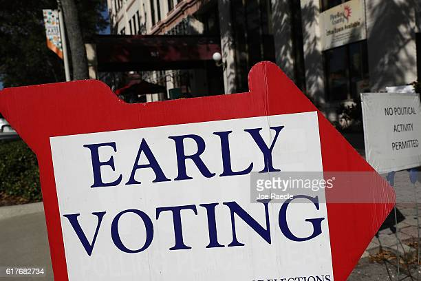 An early voting sign points voters to the polling station at the Pinellas County Election Services office on October 24, 2016 in St. Petersburg,...