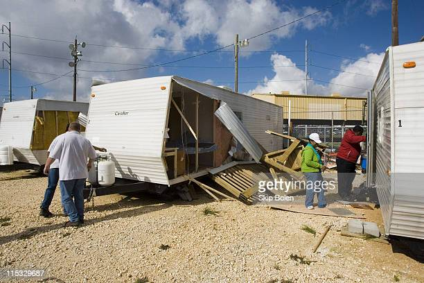 An earlymorning storm tore apart homes churches and FEMA trailers creating a trail of destruction in neighborhoods still trying to recover from...