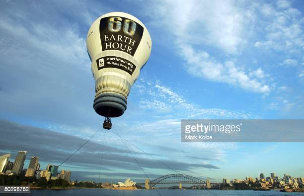 An Earth Hour lightbulbshaped hot air balloon takes flight over Sydney Harbour to promote the upcoming Earth Hour Event in Sydney Australia The event...