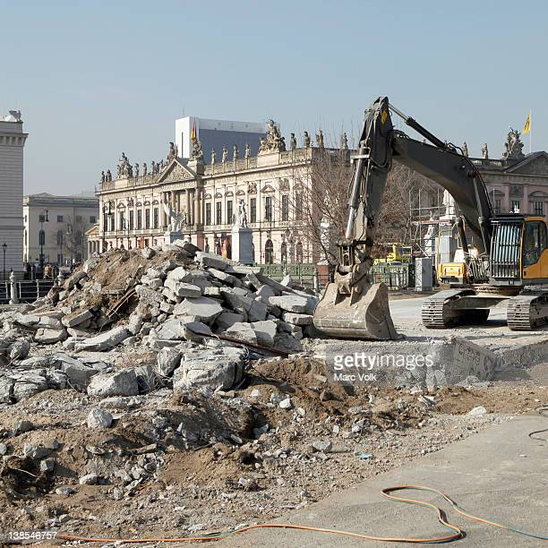 An earth mover and rubble with view of German historical museum (Zeughaus) in the background,