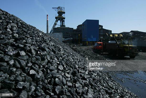 An earth mover loads a truck with freshlymined high quality coal at the Wieczorek coal mineApril 14 2004 in Katowice Poland Poland will be the...