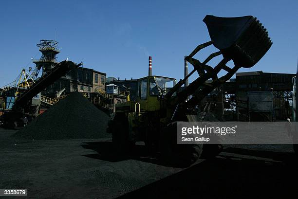 An earth mover loads a truck with freshlymined high quality coal at the Wieczorek coal mine April 14 2004 in Katowice Poland Poland will be the...