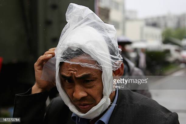 An earthquake survivor leaves the hospital on April 23 2013 in Lushan of Ya An China A magnitude 7 earthquake hit China's Sichuan province on April...