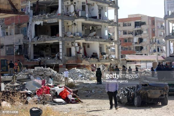 An earthquake survivor man is seen with his head down in Sarpole Zahab town of Kermanshah Iran on November 13 2017 following a 73 magnitude...