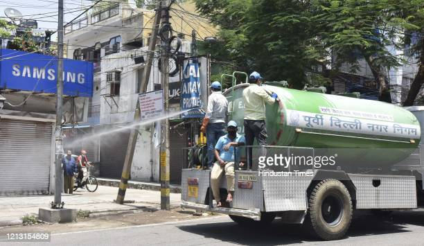 An East Delhi Municipal Corporation truck sprays disinfectant while sanitizing an area in Dilshad Garden on May 15 2020 in New Delhi India