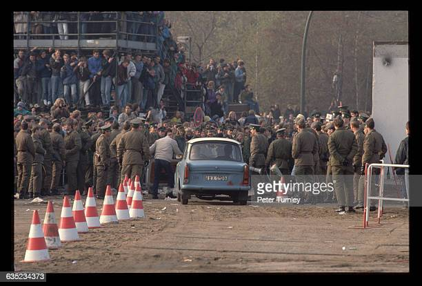 An East German attempts to drive his car through the crowd in Potsdamer Platz during the Fall of the Berlin Wall