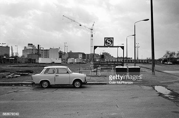 An East German Trabant motor car parked next to Potsdamer Platz SBahn station where the Berlin Wall had previously run The Berlin Wall was a barrier...