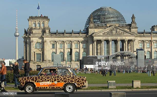An East Germanyera Trabant car drives past the Reichstag seat of Germany's federal parliament on the day of celebrations marking the 20th anniversary...
