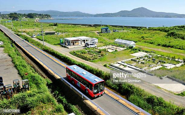 An East Japan Railways bus runs on a dedicated lane for Bus Rapid Transit rebuilt after a railway track of Kesennuma line destroyed by 2011 Great...