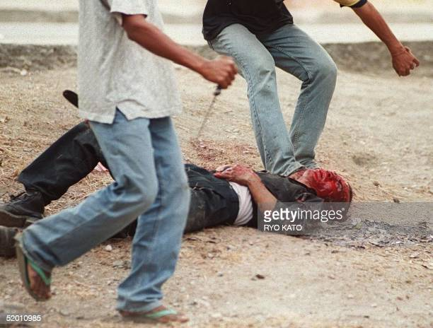 An East Timorese proautonomy supporter is stabbed to death by proindependence supporters 26 August 1999 Clashes between the two factions erupted on...