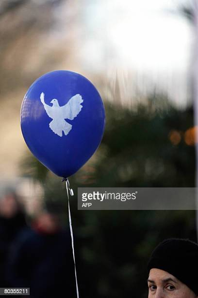 An Easter marcher holds a balloon with a peace dove as she demonstrates during a rally on Easter Monday March 24, 2008 in Berlin. Demonstrators...