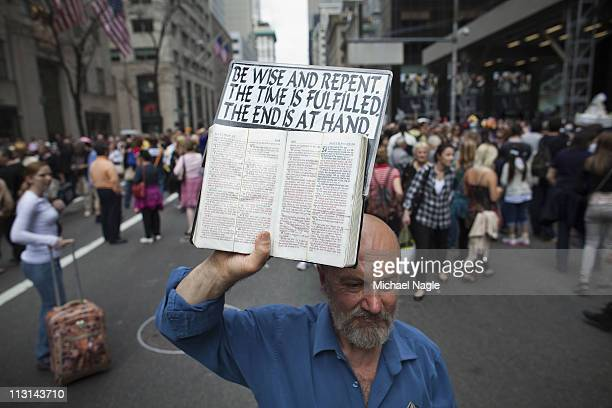 An Easter parade participant holds up a bible in the 2011 Easter Parade and Easter Bonnet Festival on April 24, 2011 in New York City. The parade is...