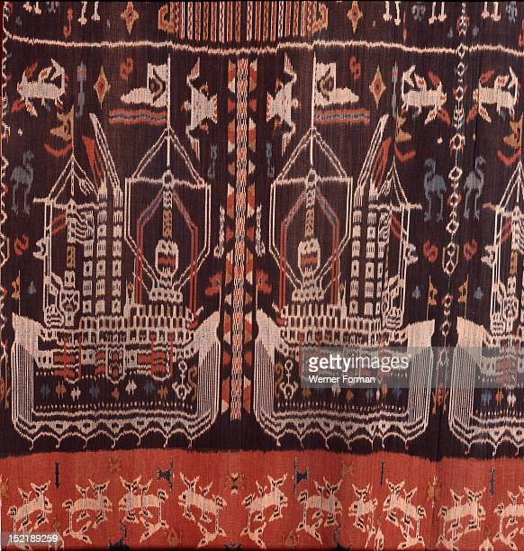 An Eastern Sumba noblemans mantle hinggi decorated by warp ikat dying the threads prior to weaving The design shows European ships of the type which...