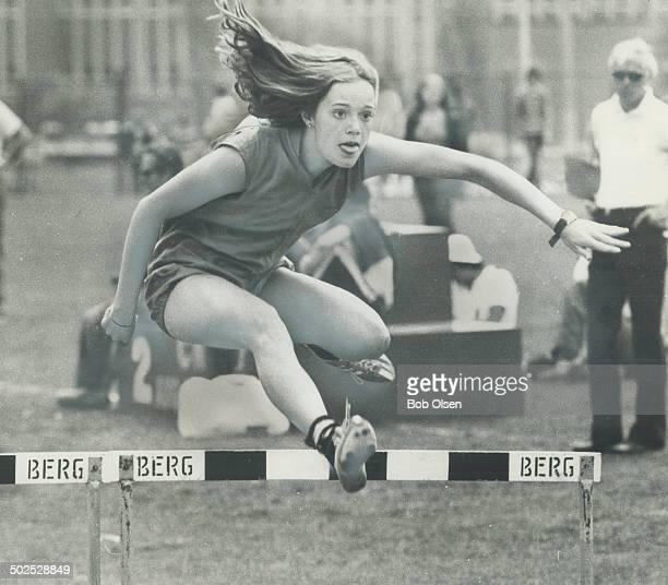 An easy hurdle Becky Jenkins of North Toronto makes it look easy as she leaps hurdle en route to winning senior girls' 80metre event during city high...