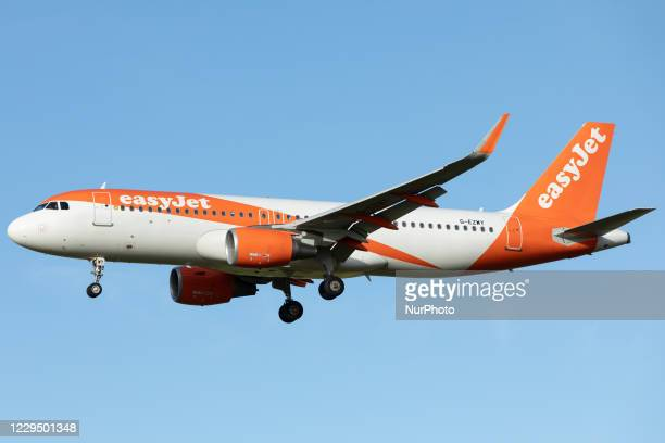An Easyjet Airbus A320 lands at Newcastle Airport on 30th October 2020